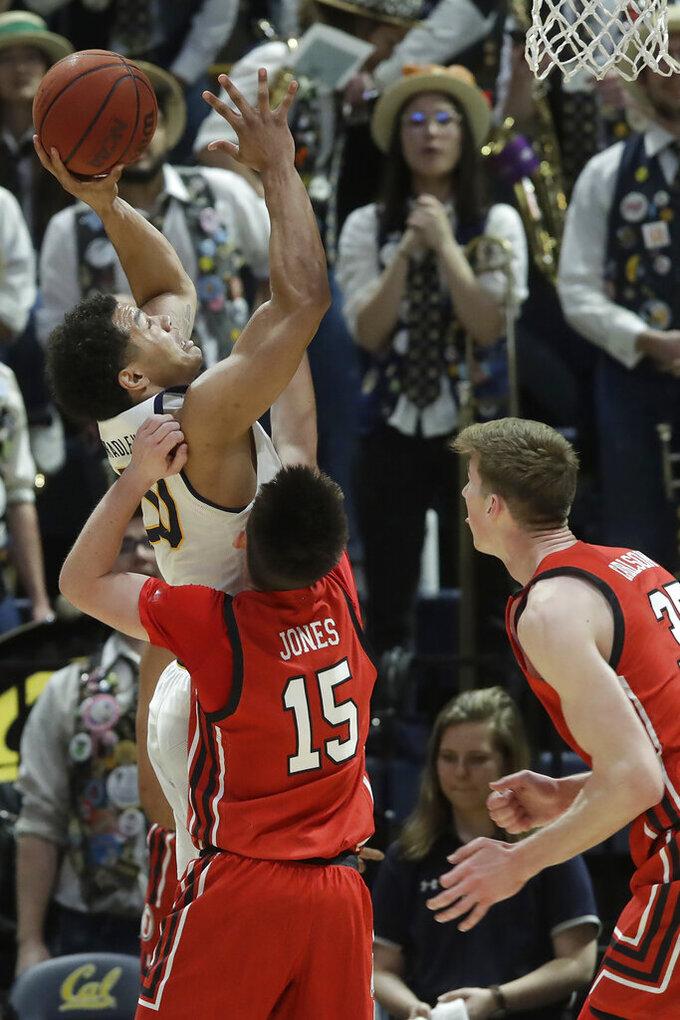 California guard Matt Bradley, top left, shoots over Utah guard Rylan Jones (15) and center Branden Carlson during the first half of an NCAA college basketball game in Berkeley, Calif., Saturday, Feb. 29, 2020. (AP Photo/Jeff Chiu)