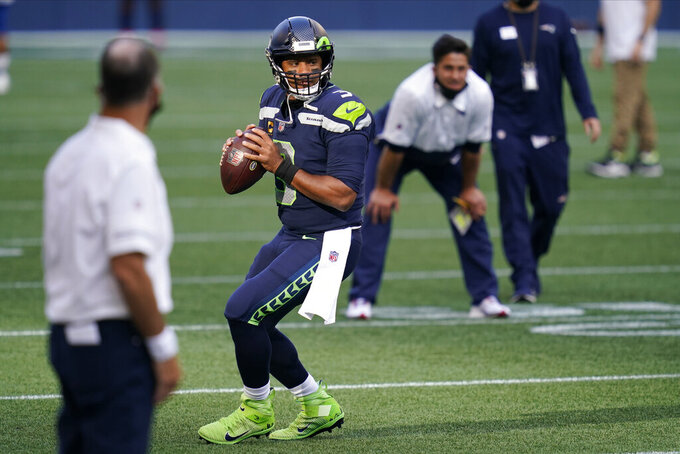 Seattle Seahawks quarterback Russell Wilson drops to pass during warmups before an NFL football game against the New England Patriots, Sunday, Sept. 20, 2020, in Seattle. (AP Photo/Elaine Thompson)
