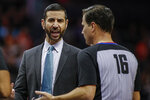 Charlotte Hornets coach James Borrego, left, argues with NBA official David Guthrie as the Hornets play the Phoenix Suns in the first half of an NBA basketball game in Charlotte, N.C., Monday, Dec. 2, 2019. (AP Photo/Nell Redmond)