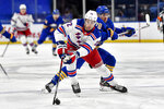 New York Rangers center Filip Chytil (72) reaches for the puck in front of Buffalo Sabres defenseman Jacob Bryson (78) during the first period of an NHL hockey game in Buffalo, N.Y., Thursday, April 1, 2021. (AP Photo/Adrian Kraus)