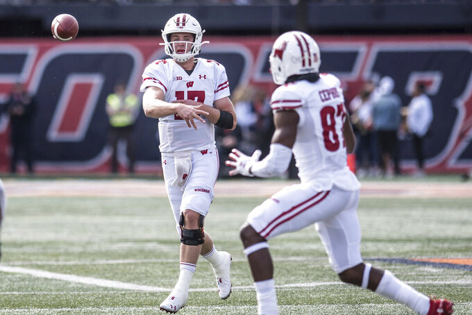 Wisconsin quarterback Jack Coan (17) throws to Quintez Cephus (87) in the first half of an NCAA college football game against Illinois, Saturday, Oct.19, 2019, in Champaign, Ill. (AP Photo/Holly Hart)