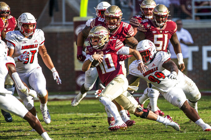 Florida State quarterback McKenzie Milton runs the ball in the second half of an NCAA college football game against Louisville in Tallahassee, Fla., Saturday, Sept. 25, 2021. Louisville defeated Florida State 31-23. (AP Photo/Mark Wallheiser)