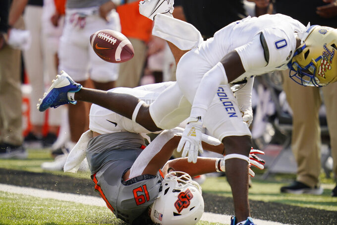 Oklahoma State wide receiver Bryson Green (19) can't hold onto a pass while defended by Tulsa cornerback Tyon Davis (0) in the first half of an NCAA college football game, Saturday, Sept. 11, 2021, in Stillwater, Okla. (AP Photo/Sue Ogrocki)