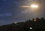 In this photo released by the Syrian official news agency SANA, shows missiles flying into the sky near international airport, in Damascus, Syria, Monday, Jan. 21, 2019. In a very unusual move, the Israeli military has issued a statement saying it is attacking Iranian military targets in Syria. It is also warning Syrian authorities not to retaliate against Israel. (SANA via AP)