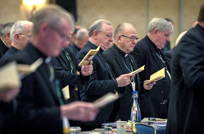 Bishops sing during an opening hymn at the start of the United States Conference of Catholic Bishops Fall General Assembly at the Baltimore Marriott Waterfront Monday, Nov. 11, 2019.  (Jerry Jackson/The Baltimore Sun via AP)