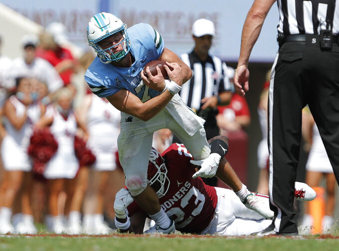 Tulane quarterback Michael Pratt (7) is tackled by Oklahoma linebacker DaShaun White (23) during an NCAA college football game Saturday, Sept. 4, 2021, in Norman, Okla. (AP Photo/Alonzo Adams)