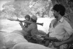 FILE - This Oct. 2, 1987, file photo shows Tamil rebels from the Peoples Liberation Organization of Tamils armed with rifles and rocket launchers on guard in northern Vavuniya town, Sri Lanka. The Indian Ocean island nation of Sri Lanka, which will elect a new president on Saturday, Nov. 16, 2019 has had a tumultuous history. Since gaining independence from British colonial rule in 1948, the country has seen three major armed conflicts in which hundreds of thousands have died. It also has had its share of natural disasters.As it prepares to elect its seventh president, Sri Lanka remains a divided nation, with ethnic, political and economic issues unresolved. (AP Photo/File)