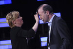 A make-up artist, left, touches up the forehead of Germany's Manfred Weber of the European People's Party, right, during a debate of the candidates to the presidency of the Commission at the European Parliament in Brussels, Wednesday, May 15, 2019. Leading candidates in the EU elections are facing off Wednesday in a final televised debate before millions of people take part in the world's biggest transnational polls on May 23-26. (AP Photo/Francisco Seco)