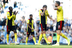 Watford's players walk off the pitch after loosing the English Premier League soccer match between Manchester City and Watford at Etihad stadium in Manchester, England, Saturday, Sept. 21, 2019. (AP Photo/Rui Vieira)