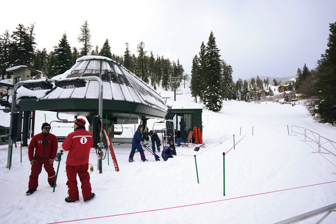 In this photograph provided by Heavenly Mountain Resort, ski lifts are prepared at Heavenly Mountain Resort Saturday, Dec. 7, 2019, in South Lake Tahoe, Calif. A winter storm brought strong wind along with heavy rain and snow across Northern California on Saturday.  (Cody Blue/Heavenly Mountain Resort via AP)