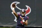 FILE - In this Dec. 27, 2020, file photo, Houston Texans quarterback Deshaun Watson throws a pass during an NFL football game against the Cincinnati Bengals in Houston.  On Friday, April 9, 2021, a judge has ordered that the name of one of the 22 women who have filed lawsuits accusing Watson of sexual assault and harassment must be made public.   (AP Photo/Matt Patterson, File)