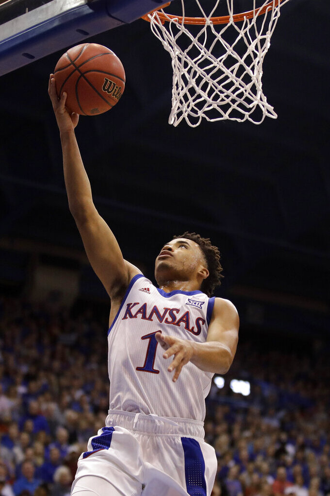 Kansas guard Devon Dotson (1) puts up a shot during the first half of an NCAA college basketball game against East Tennessee State Tuesday, Nov. 19, 2019, in Lawrence, Kan. (AP Photo/Charlie Riedel)
