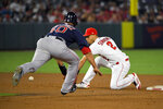 Los Angeles Angels shortstop Andrelton Simmons, right, gets set to tag out Boston Red Sox's Marco Hernandez at second on ball hit by J.D. Martinez during the sixth inning of a baseball game Friday, Aug. 30, 2019, in Anaheim, Calif. (AP Photo/Mark J. Terrill)
