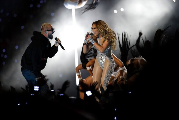 Jennifer Lopez, right, performs with Colombian reggaeton singer J. Balvin during halftime of the NFL Super Bowl 54 football game between the Kansas City Chiefs and the San Francisco 49ers Sunday, Feb. 2, 2020, in Miami Gardens, Fla. (AP Photo/Patrick Semansky)