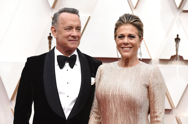 FILE - In this Feb. 9, 2020 file photo, Tom Hanks, left, and Rita Wilson arrive at the Oscars at the Dolby Theatre in Los Angeles. The couple have tested positive for the coronavirus, the actor said in a statement Wednesday, March 11. The 63-year-old actor said they will be