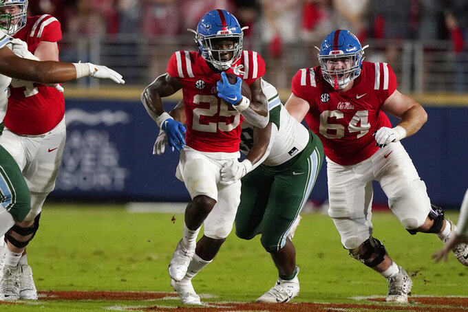 Mississippi running back Henry Parrish Jr. (25) runs for a first down against Tulane during the first half of an NCAA college football game, Saturday, Sept. 18, 2021, in Oxford, Miss. (AP Photo/Rogelio V. Solis)