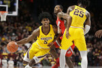Minnesota guard Marcus Carr (5) drives around a pick by Minnesota center Daniel Oturu (25) as Ohio State guard Luther Muhammad player defense in the first half during a NCAA basketball game Sunday, Dec. 15, 2019 in Minneapolis. (AP Photo/Andy Clayton-King)