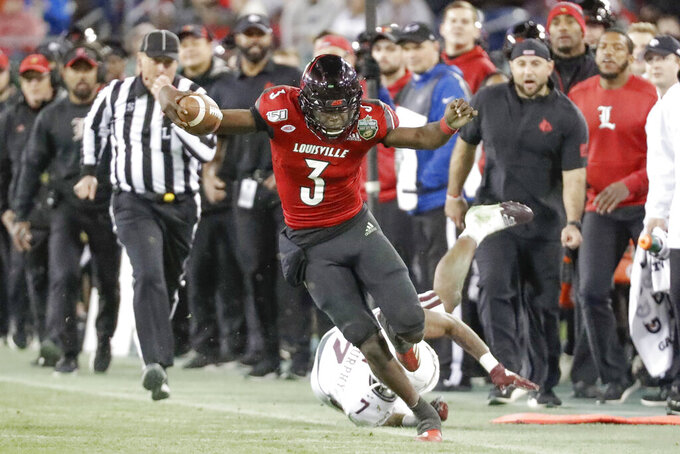 Louisville quarterback Micale Cunningham (3) tries to stay in bounds as he carries the ball against Mississippi State in the second half of the Music City Bowl NCAA college football game Monday, Dec. 30, 2019, in Nashville, Tenn. (AP Photo/Mark Humphrey)