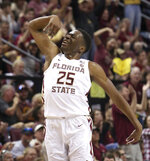 Florida State's Mfiondu Kabengele celebrates after hitting a three-point basket in the first half of an NCAA college basketball game against Louisville, Saturday, Feb. 9, 2019, in Tallahassee, Fla. (AP Photo/Steve Cannon)