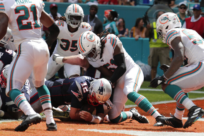 New England Patriots quarterback Tom Brady (12) scores a touchdown, during the second half at an NFL football game against the Miami Dolphins, Sunday, Sept. 15, 2019, in Miami Gardens, Fla. (AP Photo/Lynne Sladky)