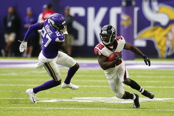 Atlanta Falcons running back Kenjon Barner (38) runs from Minnesota Vikings safety Jayron Kearse (27) during the first half of an NFL football game Sunday, Sept. 8, 2019, in Minneapolis. (AP Photo/Jim Mone)