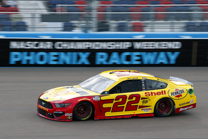 Joey Logano (22) races through Turn 4 during the NASCAR Cup Series auto race at Phoenix Raceway, Sunday, Nov. 8, 2020, in Avondale, Ariz. (AP Photo/Ralph Freso)