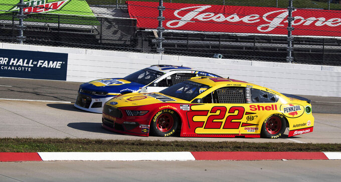 Joey Logano (22) heads into turn 3 during a NASCAR Cup Series auto race at the Martinsville Speedway in Martinsville, Va., Sunday, Nov. 1, 2020. (AP Photo/Lee Luther Jr.)