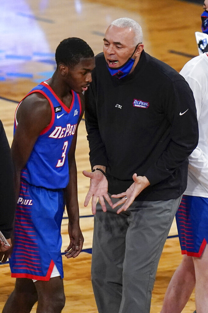 DePaul head coach Dave Leitao talks to Kobe Elvis during the first half of the team's NCAA college basketball game against Connecticut in the Big East men's tournament Thursday, March 11, 2021, in New York. (AP Photo/Frank Franklin II)