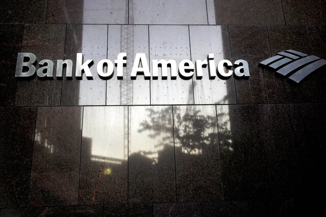 FILE - In this  Oct. 14, 2019 file photo a Bank of America logo is attached to the exterior of the Bank of America Financial Center building, in Boston. Bank of America Corp. reports financial results Wednesday, April 15, 2020. (AP Photo/Steven Senne, File)