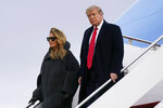 President Donald Trump and first lady Melania Trump step off Air Force One at Andrews Air Force Base, Md., Thursday, Dec. 31, 2020. Trump is returning to Washington after visiting his Mar-a-Lago resort. (AP Photo/Patrick Semansky)