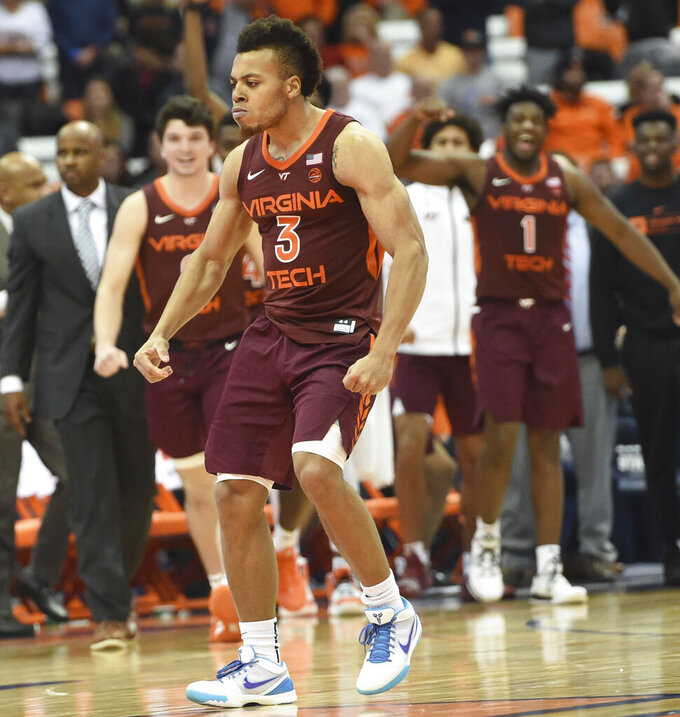 Virginia Tech guard Wabissa Bede (3) celebrates a 3-pointer that led to a Syracuse timeout during an NCAA college basketball game Tuesday, Jan. 14, 2020, in Syracuse, N.Y. (Dennis Nett/The Post-Standard via AP)