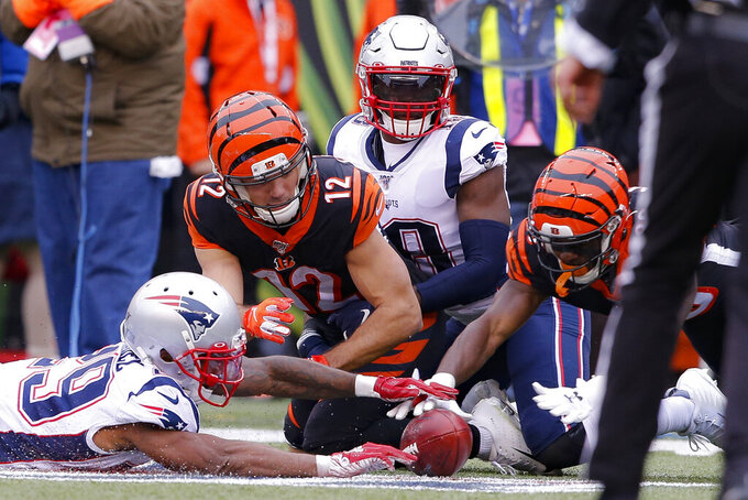 Cincinnati Bengals wide receiver Alex Erickson (12) fumbles a punt for a New England Patriots recovery in the first half of an NFL football game, Sunday, Dec. 15, 2019, in Cincinnati. (AP Photo/Gary Landers)