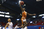 Texas junior guard Andrew Jones looks to dunk in the first half of an NCAA college basketball game  Saturday, Jan. 2, 2021, in Lawrence, Kan. (Evert Nelson//The Topeka Capital-Journal via AP)