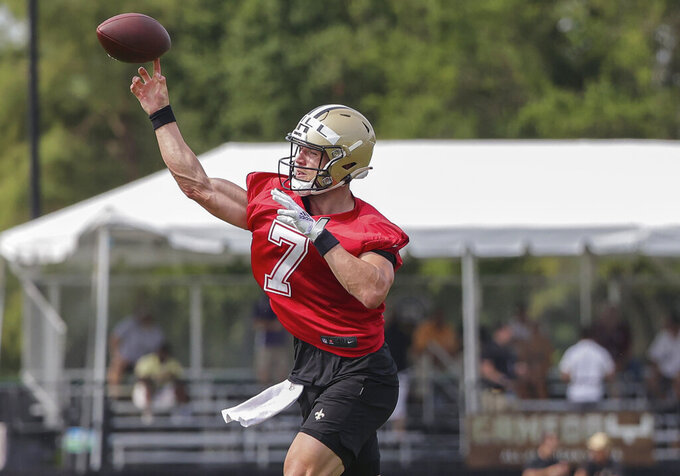 New Orleans Saints quarterback Taysom Hill (7) throws during NFL football training camp in Metairie, Friday, July 30, 2021. (AP Photo/Derick Hingle)