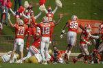 Clemson linebacker Baylon Spector(10), safety Joseph Charleston(18), and defensive end Myles Murphy(98) join in celebrating a safety during the second half of an NCAA college football game against Boston College Saturday, Oct. 31, 2020, in Clemson, S.C. (Josh Morgan/Pool Photo via AP)