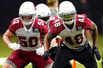 FILE - In this Aug. 31, 2020, file photo, Arizona Cardinals' Isaiah Simmons (48) and Evan Weaver (50) run drills during NFL football training camp in Glendale, Ariz. The Cardinals, who play the San Francisco 49ers this week, have added a dynamic No. 1 receiver in DeAndre Hopkins and a versatile defensive playmaker in rookie Simmons. (AP Photo/Matt York, File)