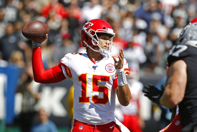 Kansas City Chiefs quarterback Patrick Mahomes looks to throw the ball during the first half of an NFL football game against the Oakland Raiders Sunday, Sept. 15, 2019, in Oakland, Calif. (AP Photo/D. Ross Cameron)