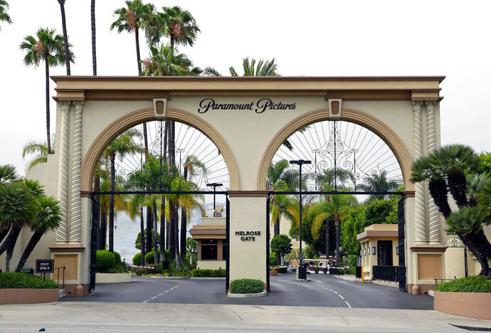 FILE - This July 8, 2015, file photo shows the main gate to Paramount Studios on Melrose Avenue in Los Angeles. Authorities have arrested a sexual assault suspect on the Paramount Pictures studio lot in Hollywood after a two-hour standoff with police. The man who was arrested early Monday, Oct. 19, 2020, 36-year-old Bryan Gudiel Barrios, works on the studio lot but it is not clear if he is a contractor or employee of Paramount Pictures.  (AP Photo/Nick Ut, File)