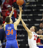 Boise State's Alex Hobbs (34) shoots as San Diego State's Malachi Flynn (22) defends during the second half of an NCAA college basketball game in the Mountain West Conference men's tournament Friday, March 6, 2020, in Las Vegas. (AP Photo/Isaac Brekken)