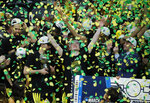 File - In this March 16, 2019, file photo, Oregon celebrates after defeating Washington 68-48 in an NCAA college basketball game in the final of the Pac-12 men's tournament in Las Vegas. Payton Pritchard wants Oregon to dominate from the start this year. Oregon is ranked No. 15 in the AP preseason poll. It is the second straight year the Ducks have been ranked to start the season. (AP Photo/John Locher, File)