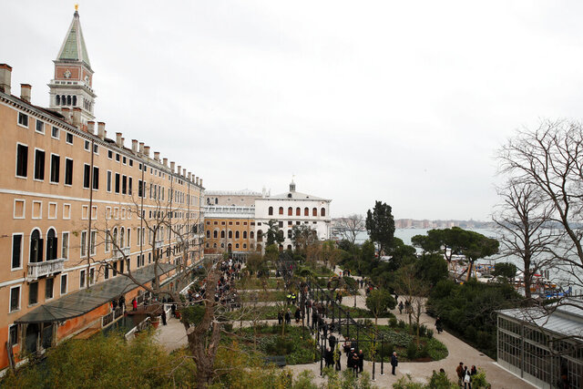 A view of the newly restored Royal Gardens in Venice, Italy, Tuesday, Dec. 17, 2019. Venice's Royal Gardens were first envisioned by Napolean, flourished under Austrian Empress Sisi and were finally opened to the public by the Court of Savoy, until falling into disrepair in recent years. After an extensive restoration, the gardens reopened Tuesday as a symbol both of the lagoon city's endurance and the necessity of public-private partnerships to care for Italy's extensive cultural heritage. (AP Photo/Antonio Calanni)