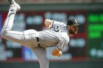 Chicago White Sox pitcher Lucas Giolito throws against the Minnesota Twins in the eighth inning of a baseball game Wednesday, Aug. 21, 2019, in Minneapolis. Giolito pitched a complete three-hit shutout game as the White Sox won 4-0. (AP Photo/Jim Mone)