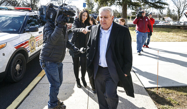 FILE - In this Feb. 27, 2020 file photo, former state Sen. Mike Folmer leaves the Lebanon County courthouse, in Lebanon, Pa.  Folmer is headed to county jail for possession of child pornography in a case that prompted him to resign and plead guilty. Folmer, a Republican who represented a district in Lebanon County, spoke in court Tuesday, July 21 before being sentenced to one to two years in county jail.  (Dan Gleiter/The Patriot-News via AP, File)