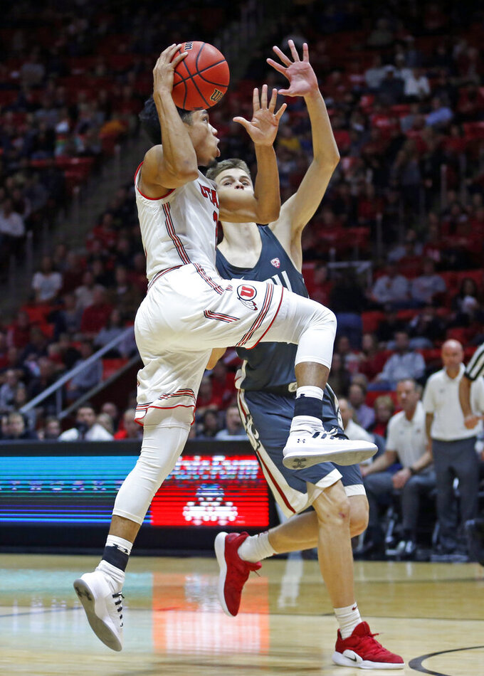 Utah guard Sedrick Barefield, left, goes to the basket as Washington State forward Aljaz Kunc, rear, defends during the second half of an NCAA college basketball game Saturday, Jan. 12, 2019, in Salt Lake City. (AP Photo/Rick Bowmer)