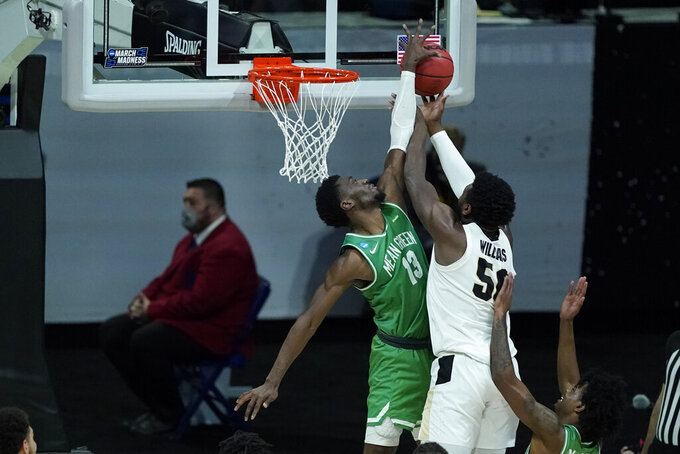 Purdue's Trevion Williams (50) has his shot blocked by North Texas's Thomas Bell (13) during the second half of a first-round game in the NCAA men's college basketball tournament at Lucas Oil Stadium, Friday, March 19, 2021, in Indianapolis. (AP Photo/Darron Cummings)