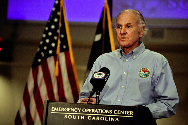 South Carolina Gov. Henry McMaster, right, speaks at a COVID-19 briefing on Friday, April 3, 2020, in West Columbia, S.C. (AP Photo/Meg Kinnard)