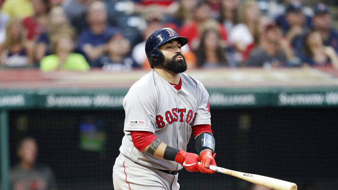 In this Aug. 13, 2019 photo Boston Red Sox's Sandy Leon watches his ball after hitting against the Cleveland Indians in the fourth inning of a baseball game in Cleveland. The Indians have acquired Leon in a trade from the Red Sox. Cleveland sent minor league right-hander Adenys Bautista to Boston on Monday, Dec. 2, 2019 for the 30-year-old Leon, who has split his eight-year major league career between Boston and Washington. (AP Photo/Tony Dejak)