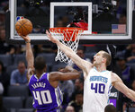 Sacramento Kings forward Harrison Barnes, left, goes to the basket against Charlotte Hornets forward Cody Zeller, right, during the first quarter of an NBA basketball game in Sacramento, Calif., Wednesday, Oct. 30, 2019. (AP Photo/Rich Pedroncelli)