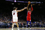 Philadelphia 76ers' Josh Richardson, right, goes up to shoot against Miami Heat's Meyers Leonard, left, during the second half of an NBA basketball game, Saturday, Nov. 23, 2019, in Philadelphia. (AP Photo/Matt Slocum)