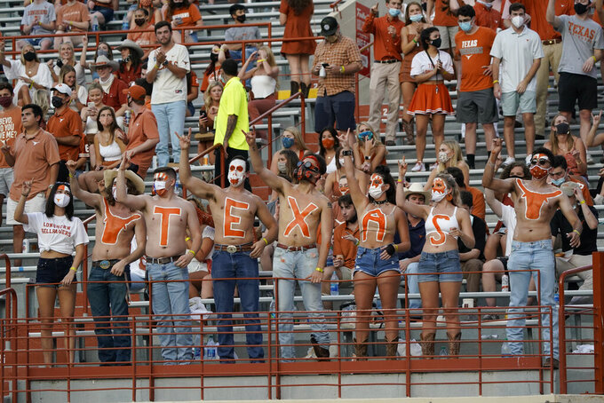 Texas fans cheer before the team's NCAA college football game against UTEP in Austin, Texas, Saturday, Sept. 12, 2020. (AP Photo/Chuck Burton)